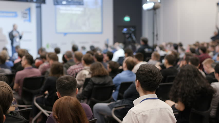 Modern space for startup company of programmers career. Commerce activity for cooperation and success in large crowded room. Speaker says about successful financial marketing in full place of viewers | Shutterstock HD Video #1012115240
