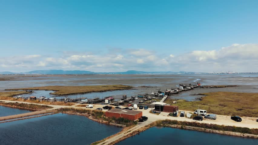 Aerial rotating pan view of the Carrasqueira harbour in Comporta, Portugal.
