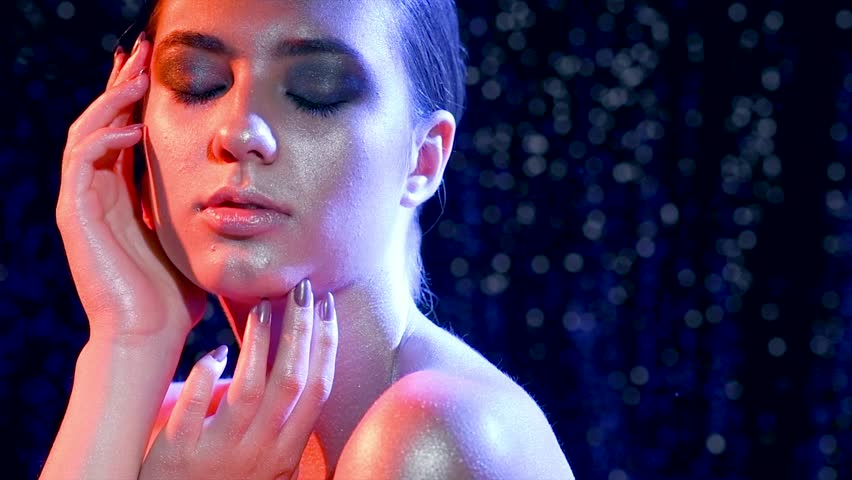 High Fashion model woman in colorful bright sparkles and neon lights posing in studio, portrait of beautiful girl, trendy glowing make-up. Art design colorful make up. Glitter Vivid makeup 4K | Shutterstock HD Video #1012190210