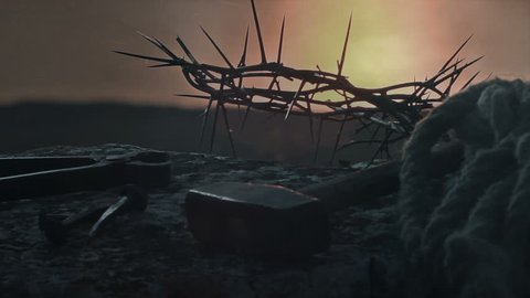 Crucifixion of Jesus Christ.Crown of thorns with nails, hammer, pliers and a rope placed on a stone.