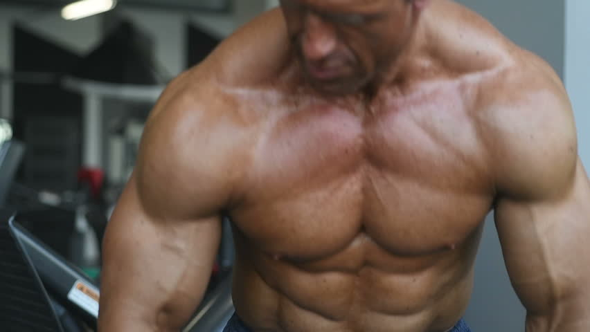 Slow motion handsome strong bodybuilder athletic man pumping up muscles workout bodybuilding concept background - muscular bodybuilder handsome men doing exercises in gym naked torso sport and diet   Shutterstock HD Video #1012238660