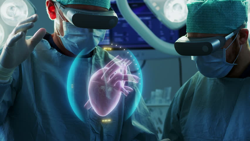 Surgeons Wearing Augmented Reality Glasses Perform Heart Surgery with Help of Animated 3D Heart Model. Doing Difficult Heart Transplant Operation Using Gestures.  Shot on RED EPIC-W 8K Helium Camera. | Shutterstock HD Video #1012263470