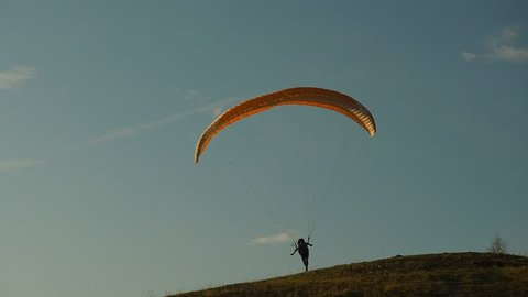 Silhouette Man Paragliding Beautiful Summer Sunset Sky. Paraglide flight experience skydive summer