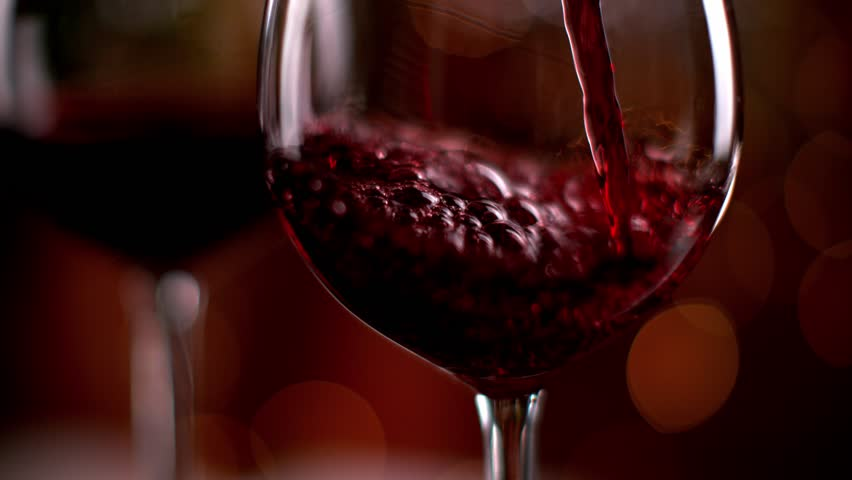Super slow motion of pouring red wine from bottle into goblet. Shot on high speed cinema camera with 1000fps 4K resolution.
