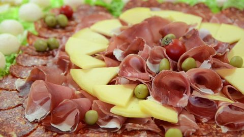 Smoked meat and cheese on a plate. Arranged dried meat in restaurant. Appetizing. Cured meat platter