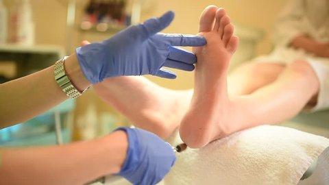 Pedicure dead skin remover foot rasp woman in nail salon? The process of creating a pedicure. Beauty and pedicure salon. Hardware pedicure.