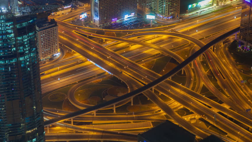 Dubai highway intersection traffic transport node night time-lapse #1012335650