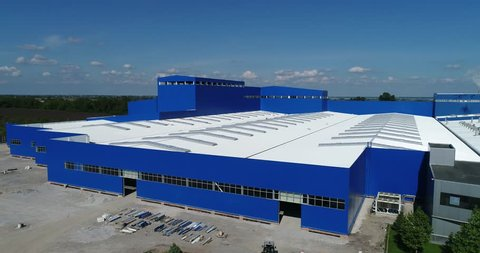 construction of a modern production building or factory, the exterior of a large modern production plant or factory, industrial exterior, modern production exterior, industrial exterior, aerial view
