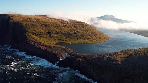 Aerial view on The Faroe (Føroyar) Islands (Denmark). Flying with drone at the Sørvágsvatn Lake and Bøsdalafossur Waterfall