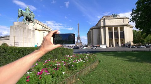 Professional video series of POV taking selfie on Eiffel Tower and Marshal Ferdinand Foch statue in Paris in 4K slow motion 60fps