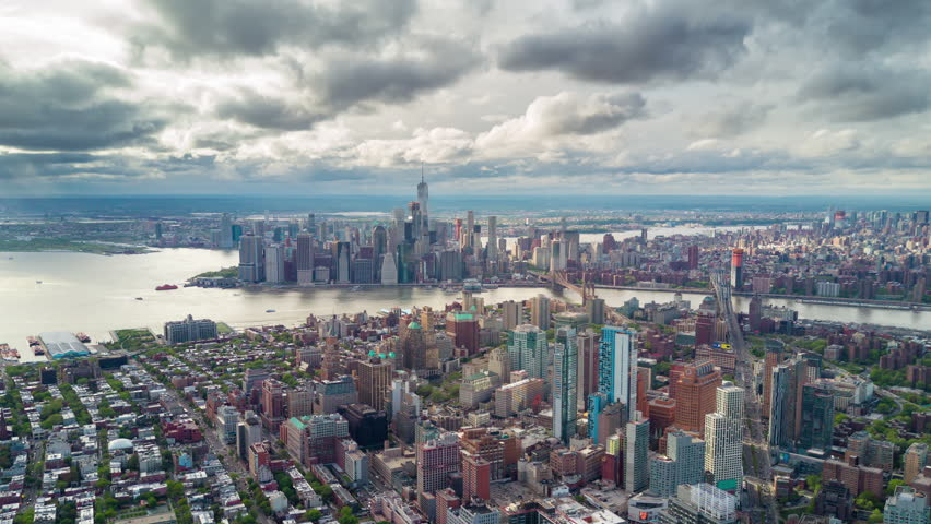 Aerial view of Brooklyn and Manhattan, New York City. Tall buildings. Sunny day, aerial timelapse. Clouds on background. | Shutterstock HD Video #1012402220