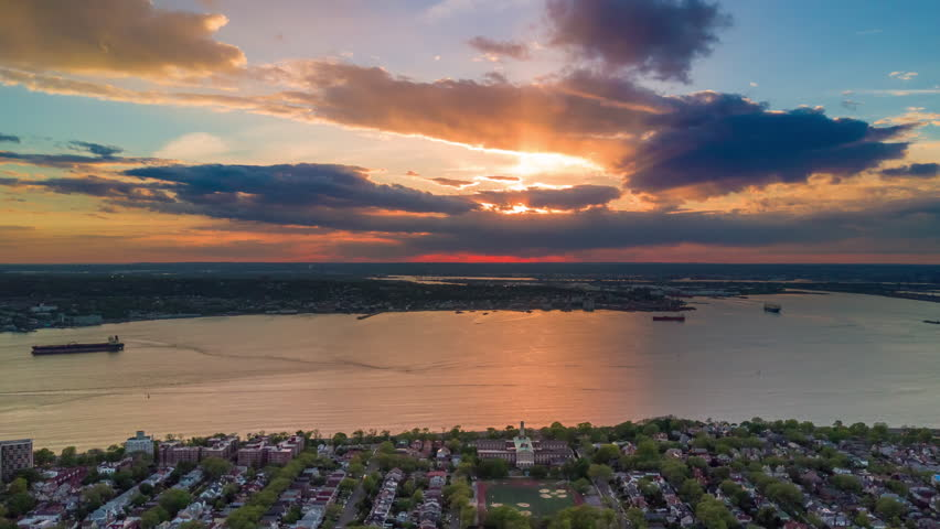 Aerial view on sunset above Brooklyn, New York City. Timelapse dronelapse. Clouds and sun. | Shutterstock HD Video #1012402280