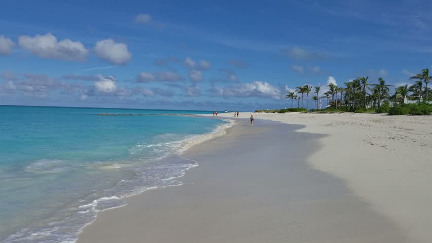 people walking along beach in Grace Bay, Providenciales, Turks and Caicos