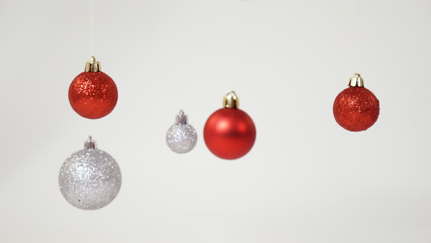Red and silver Christmas balls hanging | Shutterstock HD Video #1012461740