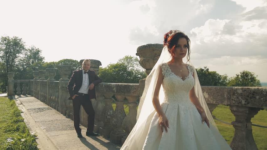 Bride walking away from groom. Lovely wedding couple | Shutterstock HD Video #1012519040