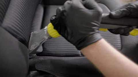 Close up shot of a professional cleaning car seat.
