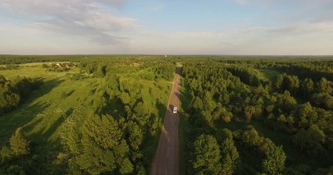 4K high quality sunny summer sunset early evening video of green fields and forests near picturesque Gorki village, rural road near Pereslavl-Zalesskiy on Golden Ring route 120 km from Moscow, Russia