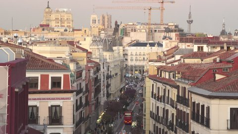 Downtown Madrid cityscape, skyline. Calle Mayor street - April 2018: Madrid, Spain