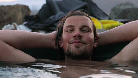 Man in geothermal hot pool in Iceland