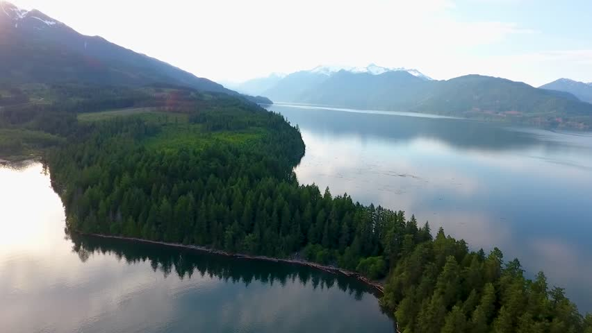 Harrison Lake and forest with mountain range in background in beautiful British Columbia near Vancouver