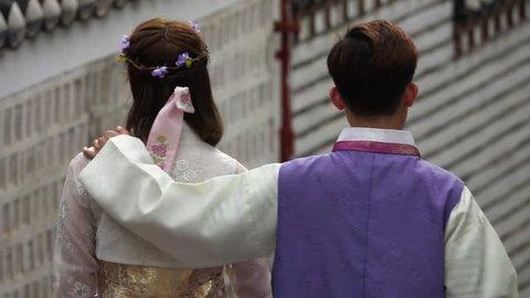 People Walking in Traditional Korean Costume Hanbok at Traditional Bukchon Folk Village in South Korea