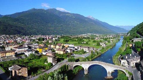Adda river and city of Morbegno in Valtellina. Aerial view