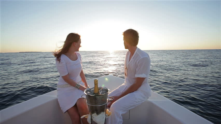 Young Honeymoon Couple Drinking Champagne On A Boat At Sunset Stock Footage Video 1012696 ...