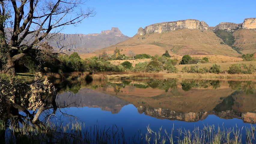Drakensberg mountains with symmetrical reflection in water, Royal Natal National Park, South Africa
