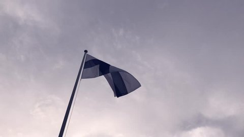 Finnish flag and dark sky. Waving Flag of Finland Against sky