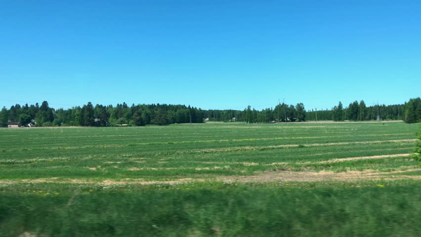 View from train window, Finland,fields with houses