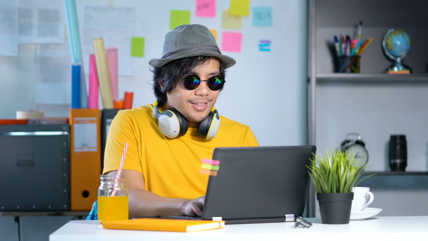 Young Man Working and Enjoying Music on Summer Vacation Season at Office 4k