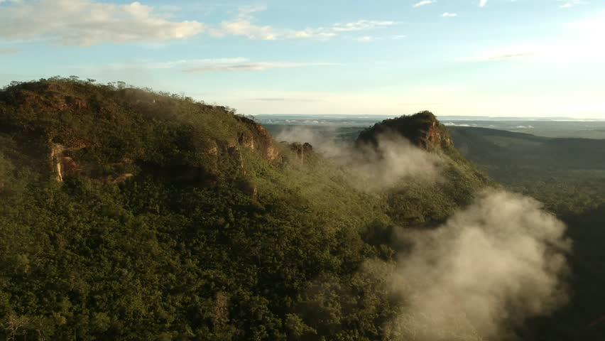 Aerial view of the mountains covered by clouds in the Chapada dos Guimaraes - Brazil   Shutterstock HD Video #1012768880