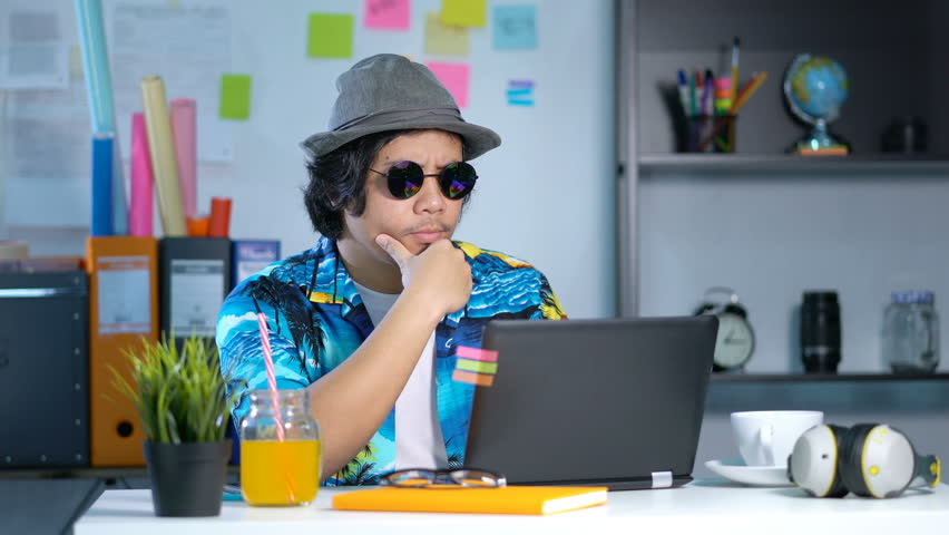 Hawaiian Young Man Working With Laptop on Summer Vacation Season at Office 4K