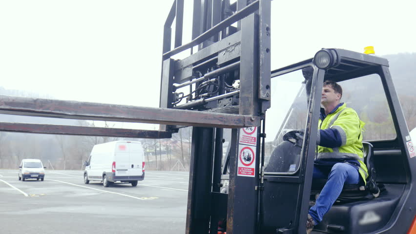 Professional forklift driver carefully picking cargo from trailer 4K. Medium shot of forklift driver in focus while operating the forks.   Shutterstock HD Video #1012831490
