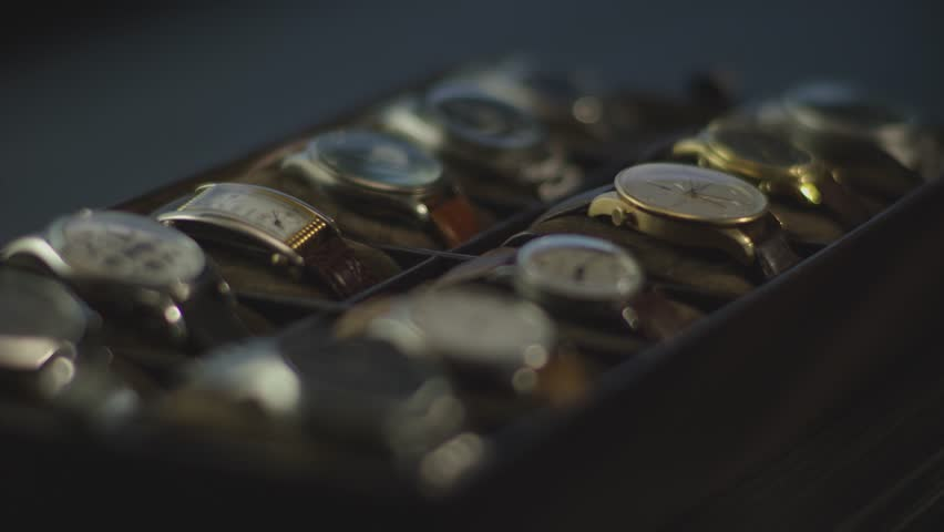 Watches collection lit by a graceful light | Shutterstock HD Video #1012851080