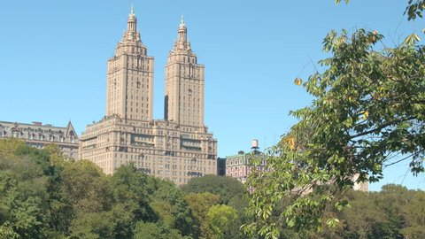CLOSE UP: View of luxury residential building San Remo from Central Park, New York. Beautiful apartment building in Manhattan Upper West Side overlooking the Lake and green space in urban environment
