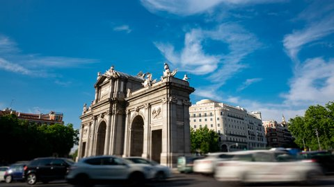 Long exposure timelapse with traffic in Puerta de Alcala, Madrid, Spain. Profile view