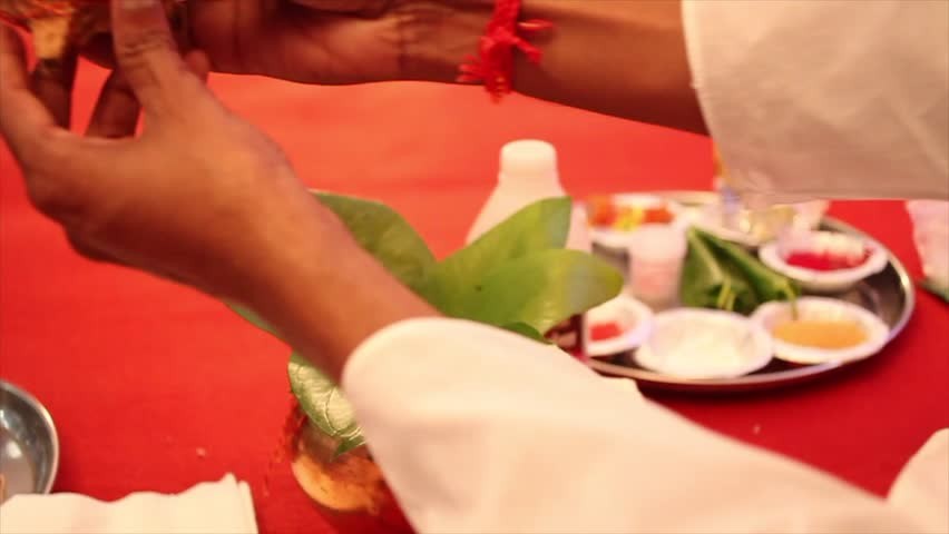 Hindu Rituals of Indian wedding by pandit with coconut