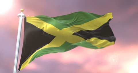Flag of Jamaica waving at wind at sunset in slow, loop