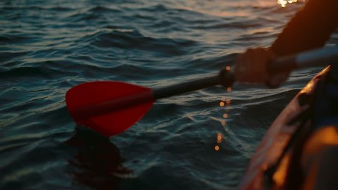 Close-up of a paddle boat at dawn. in slow motion