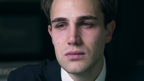 Sad depressed young attractive Buisness man crying alone in his office