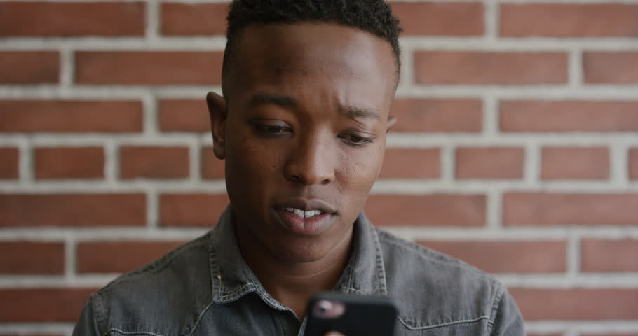 Portrait of young African American man student using smartphone #1013086190