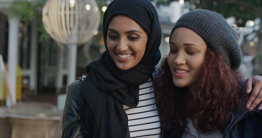 Portrait of young multi ethnic women friends taking selfie | Shutterstock HD Video #1013087870