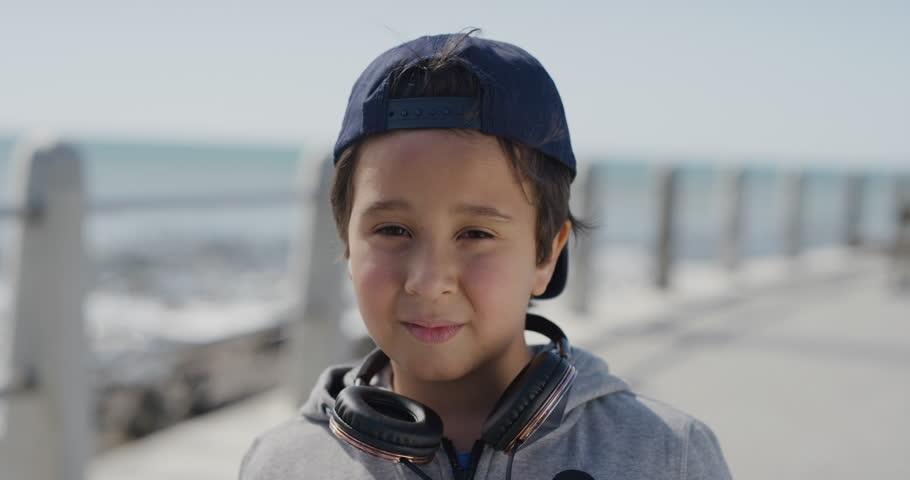 Portrait little boy looking calm pensive enjoying summer vacation on warm seaside beach slow motion | Shutterstock HD Video #1013096570