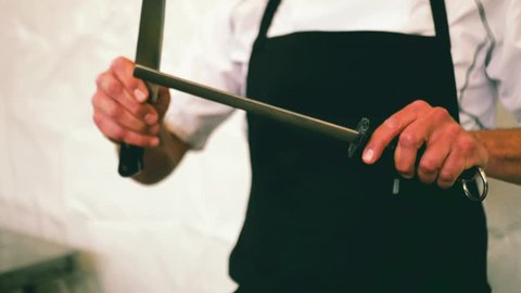 Knife sharpening by an expert chef in Slow motion