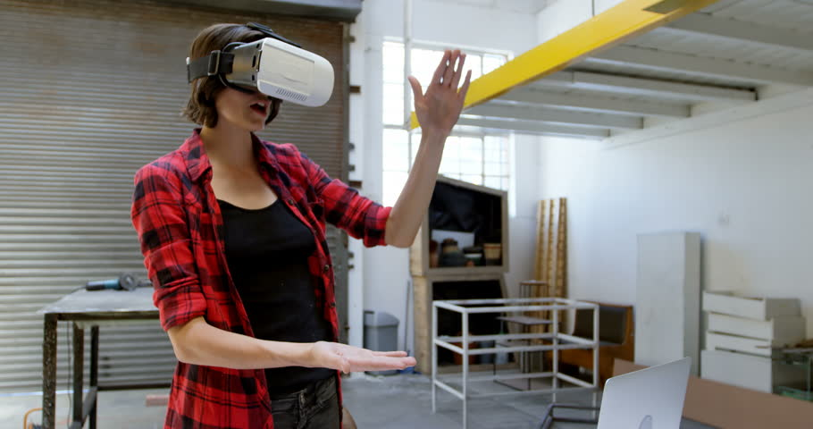 58a0b65d83f4 Female Welder Using Virtual Reality Stock Footage Video (100 ...