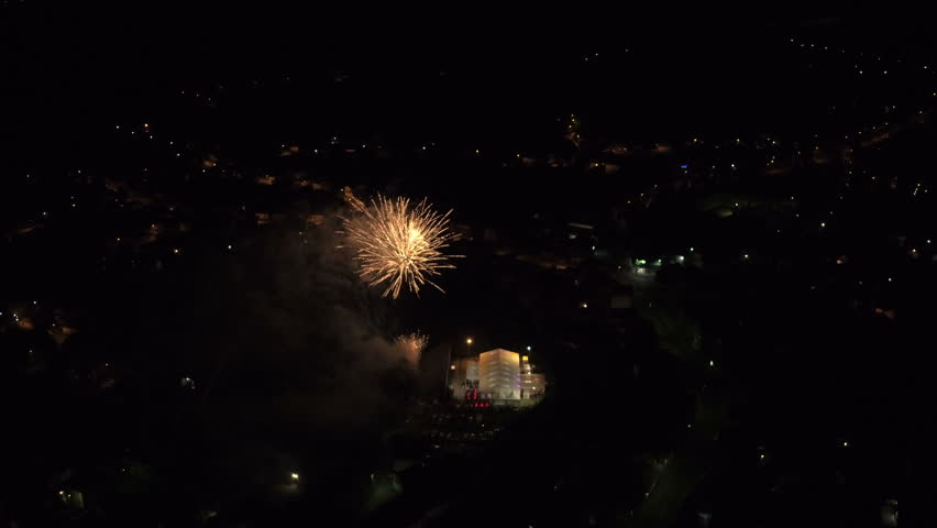 Spectacular fireworks of various kinds above the city at night | Shutterstock HD Video #1013171090