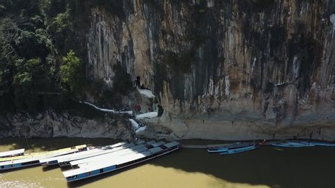 Tourists and Boats on the Mekong River in Front of the Pak Ou Caves