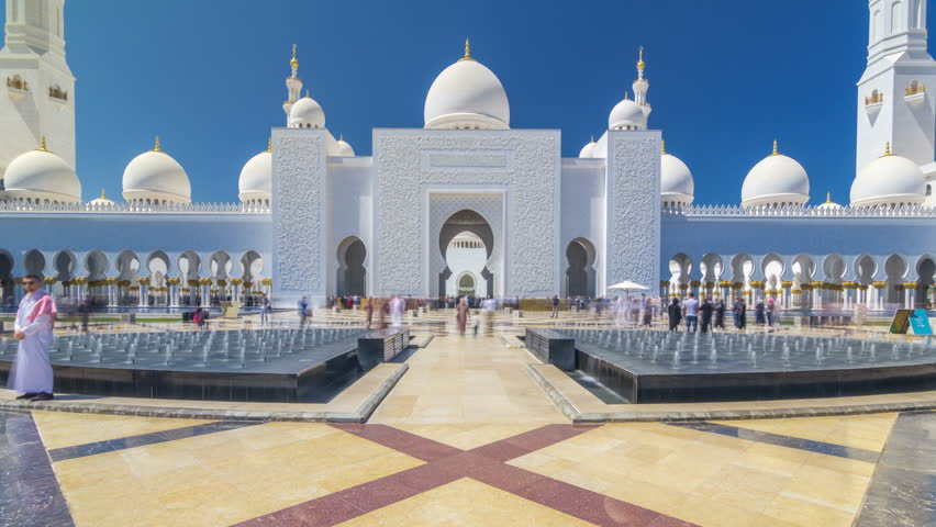 Sheikh Zayed Grand Mosque timelapse hyperlapse in Abu Dhabi, the capital city of United Arab Emirates. Front view with fountains. Blue sky at sunny day | Shutterstock HD Video #1013213270