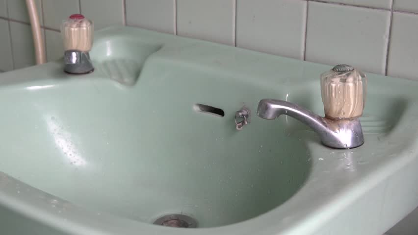 Faucet with water in the bathroom.Water drop. Slow Motion 120 fps. | Shutterstock HD Video #1013222390